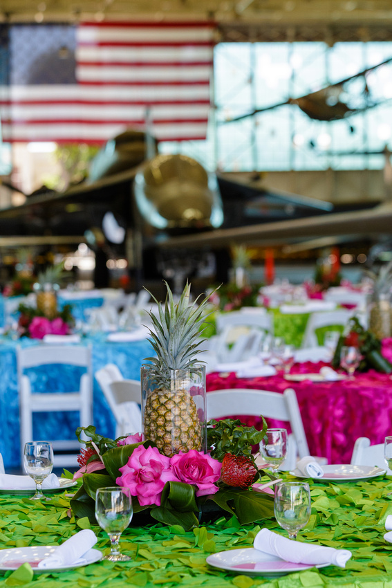 A tropical centerpiece adds levity and style to the seriousness of the WWII fighter jets!