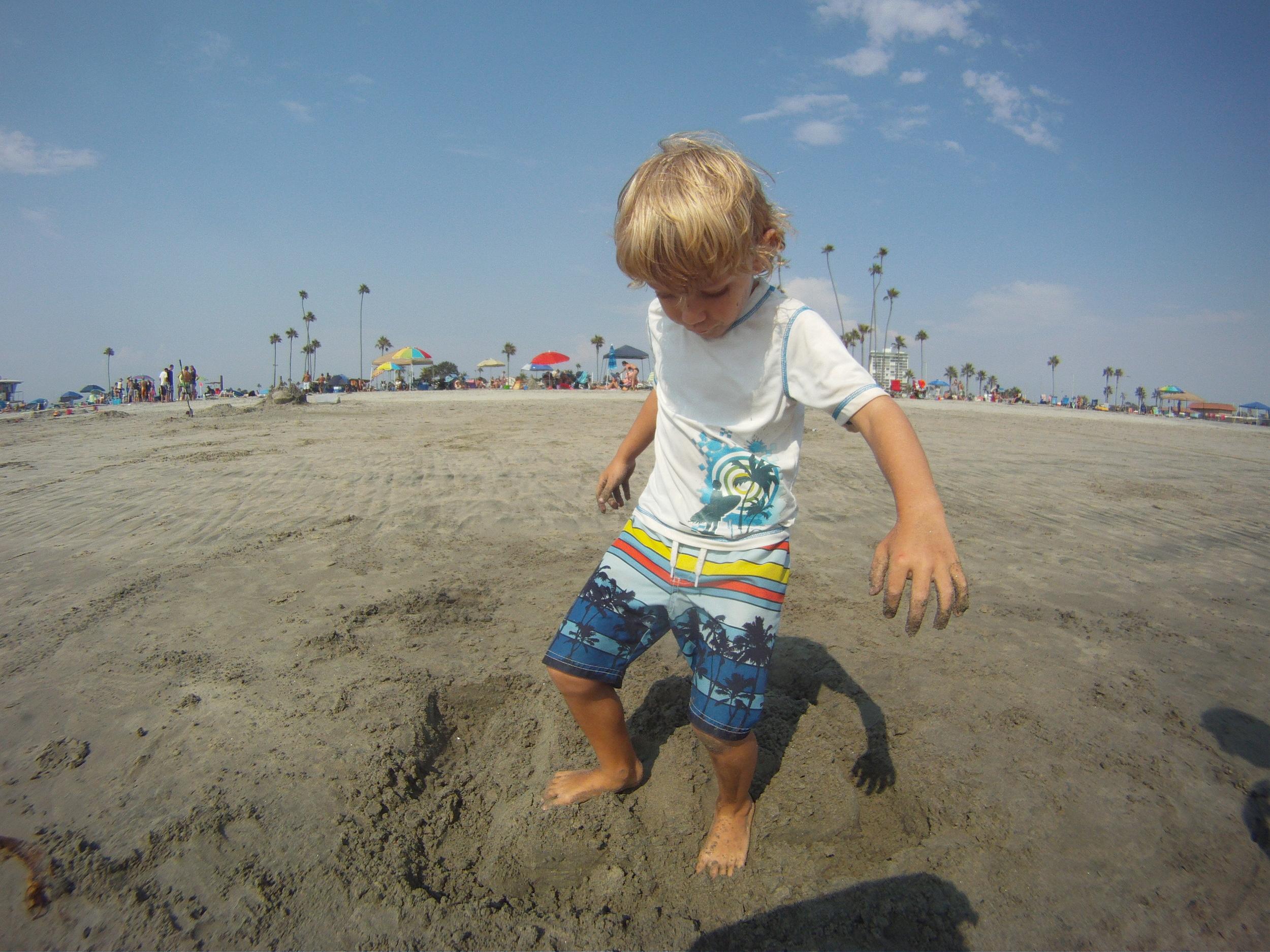 Hunter destroying a sandcastle