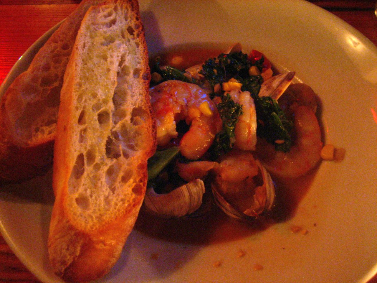 Slyvain's: Gulf shrimp and littleneck clams with ham hock broth. AMAZING.