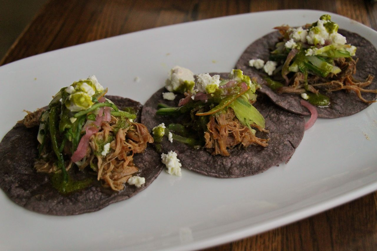 Goat tacos with feta, cucumber-red onion slaw, dill, mint & chimichurri
