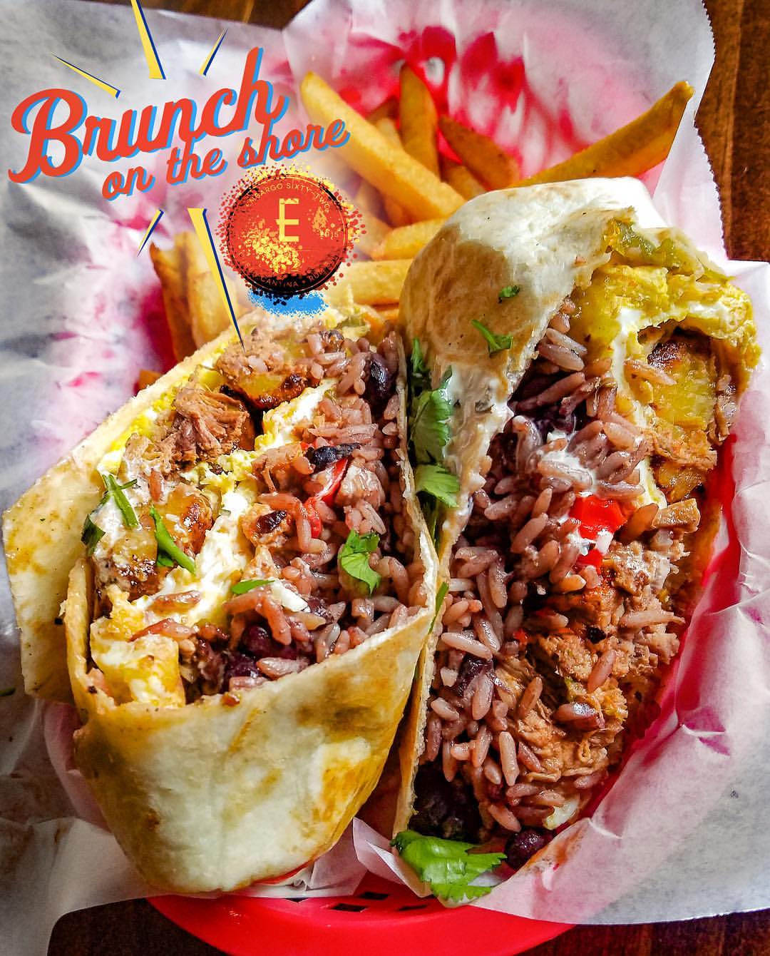 Embargo '62 Brunch Burrito. Fried Eggs, Congri (rice and beans mix), Sweet Plantains, Ropa Vieja (shredded beef), Mayonesa de cilantro, Potato Sticks in a Flour Tortilla.