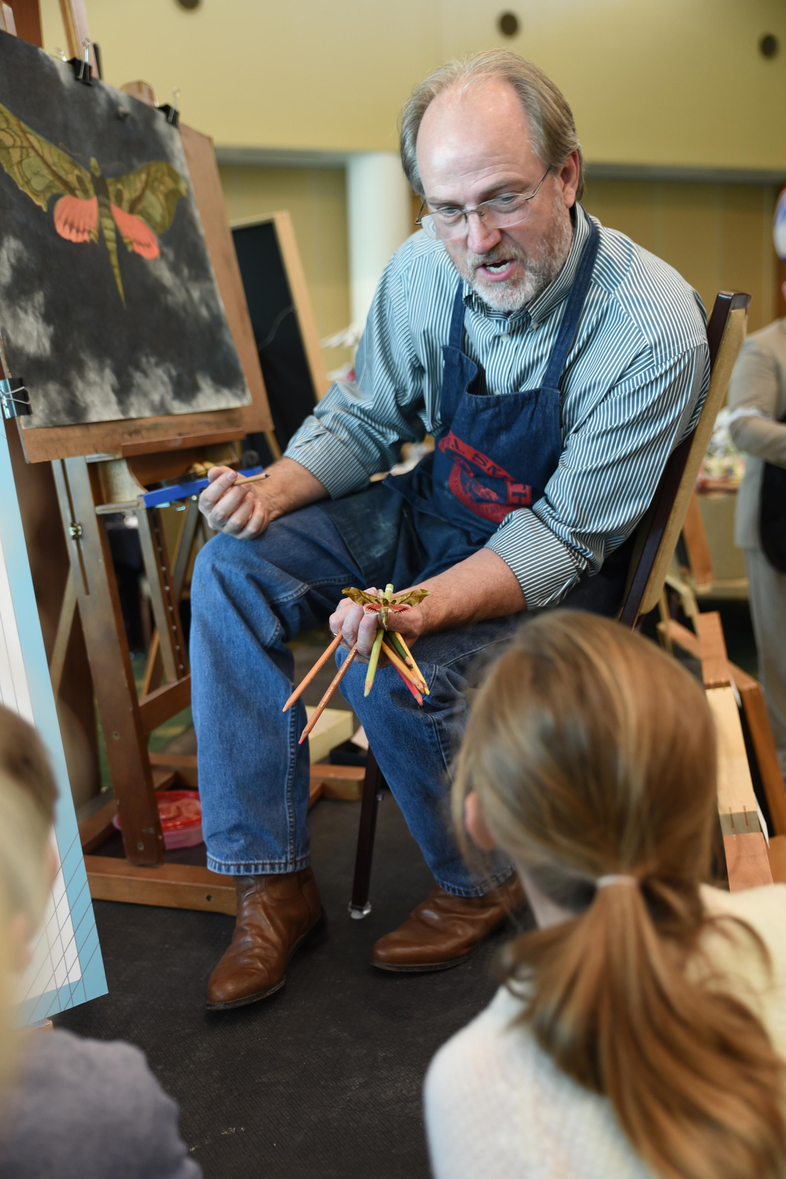 Artist Greg Lewallen explains his process to Hillcrest PDS students.