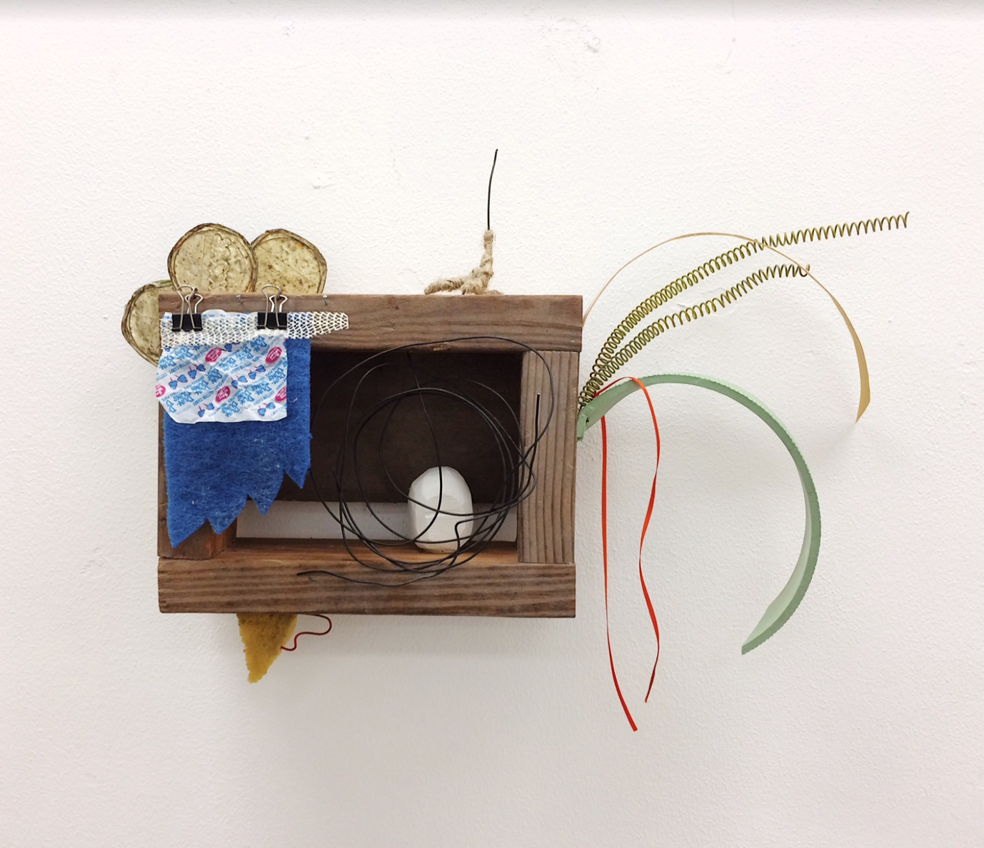 """Gabrielle Peralta    Nest Egg,  Found Objects: (Wood, Wire, Plaster, Twine, and Oil Paint, 12"""" x 24"""" x 10"""""""