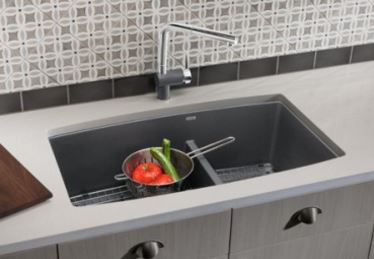 Undermounted granite composite sink, with low divider