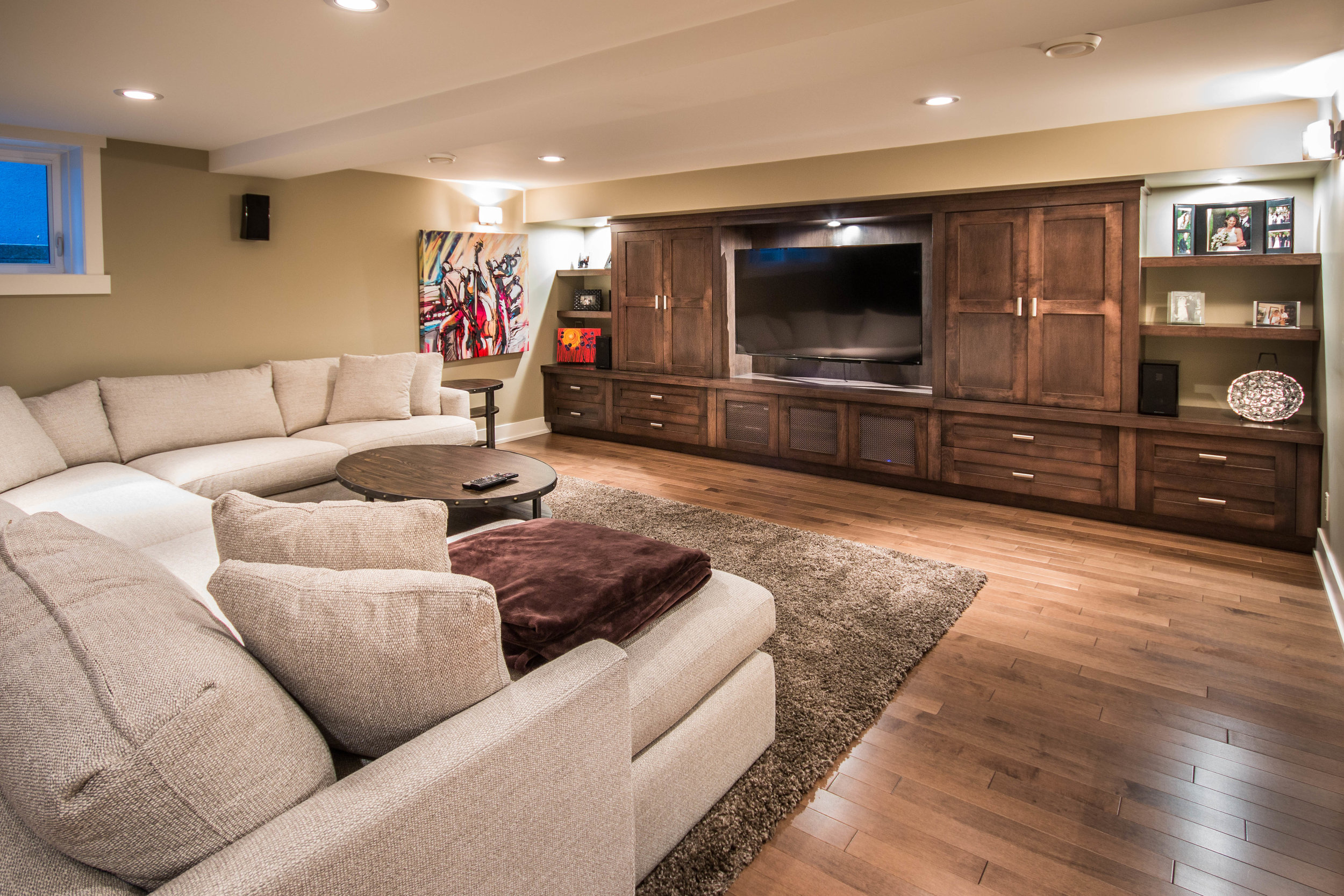 Basement living room with built ins