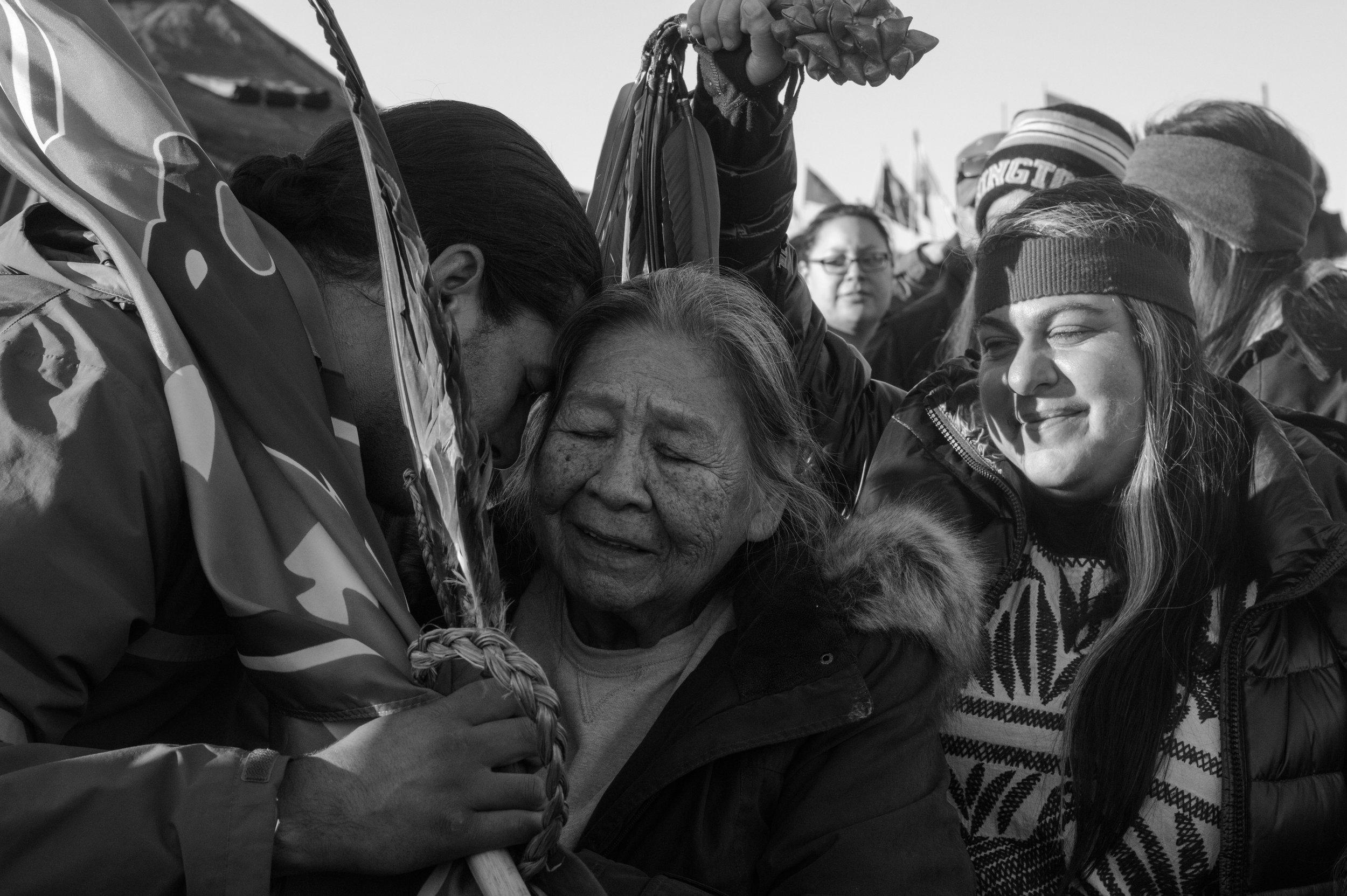 emotional embrace of a elder and veteran