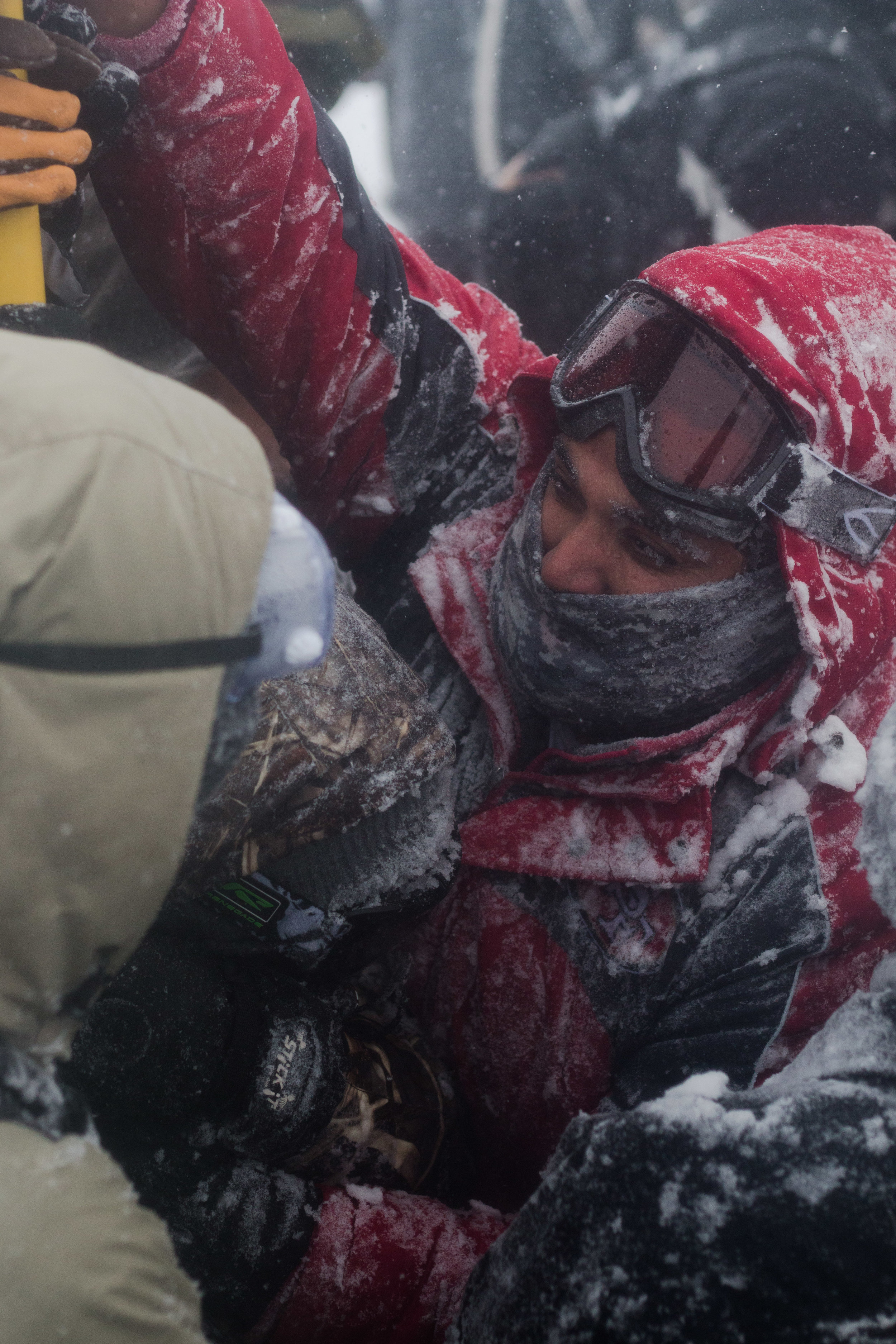 veterans fight against the blizzard conditions to hold p an American flag