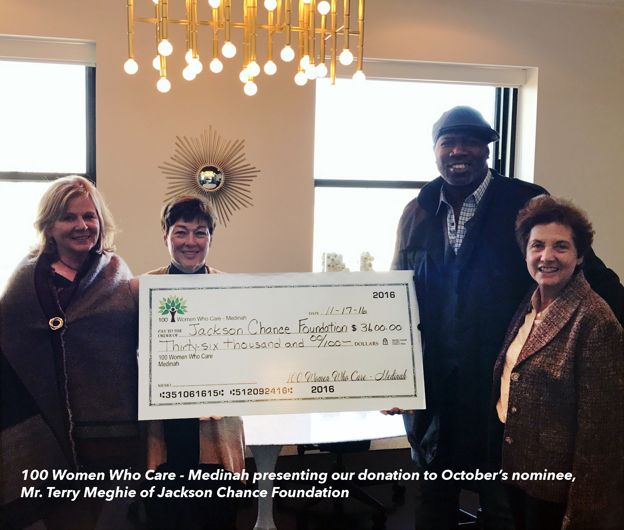100 WWC-Medinah present our checks to co-founder and Jackson's father, Mr. Terry Meghie