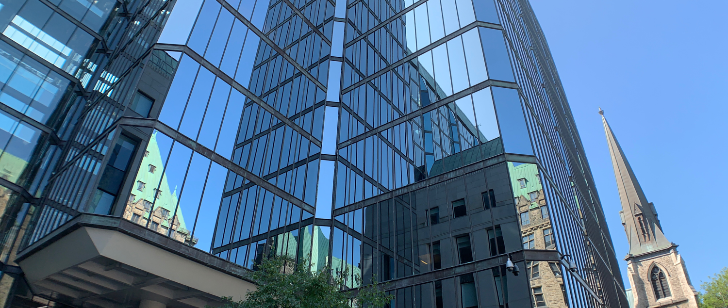 Glass reflections on the Bank of Canada: 45.421028, -75.703651