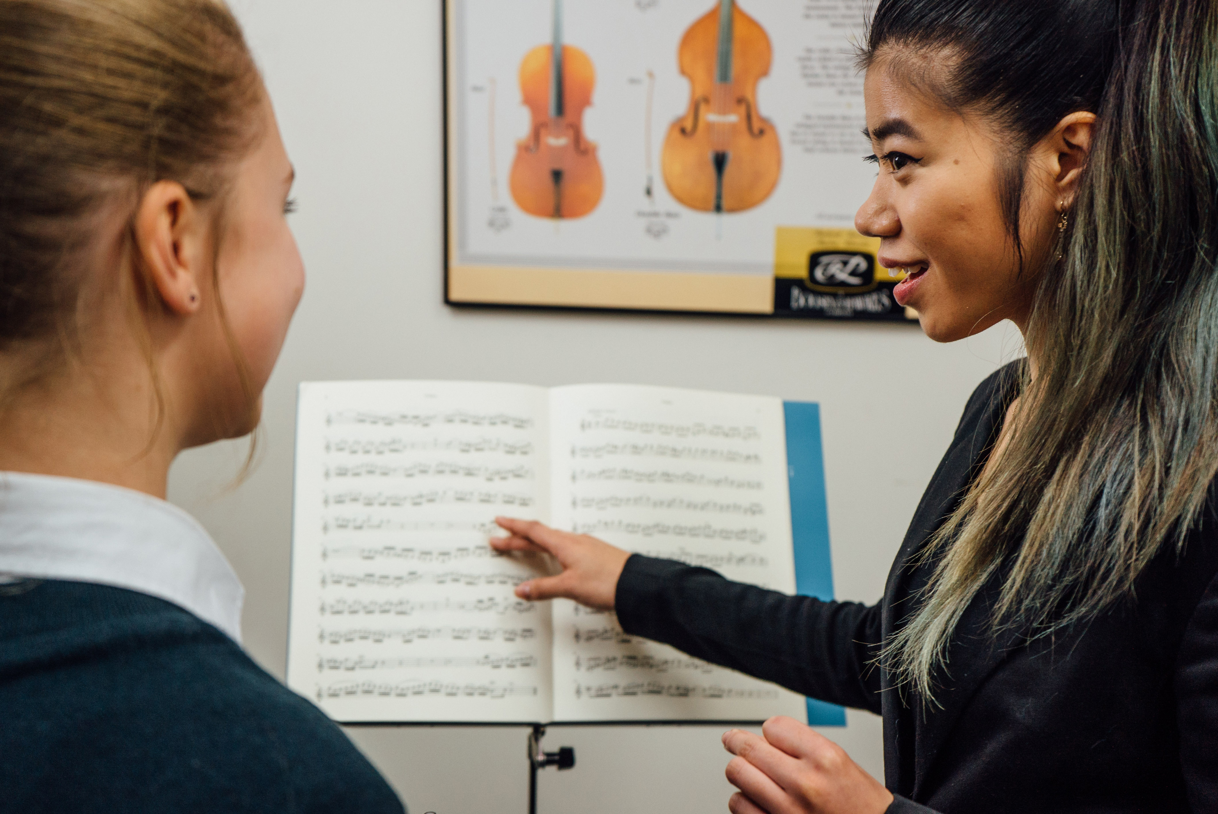 Girl learning music from her teacher
