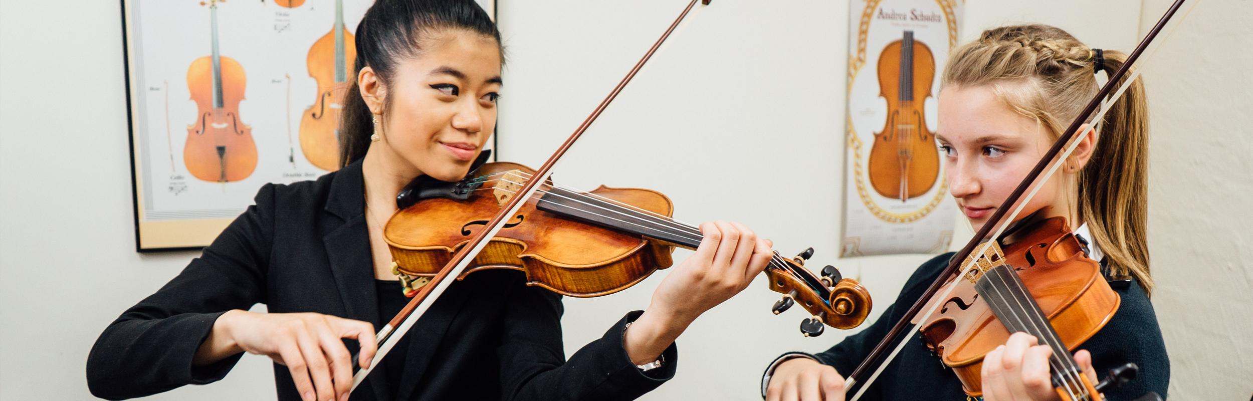 Girl enjoying a violin lesson