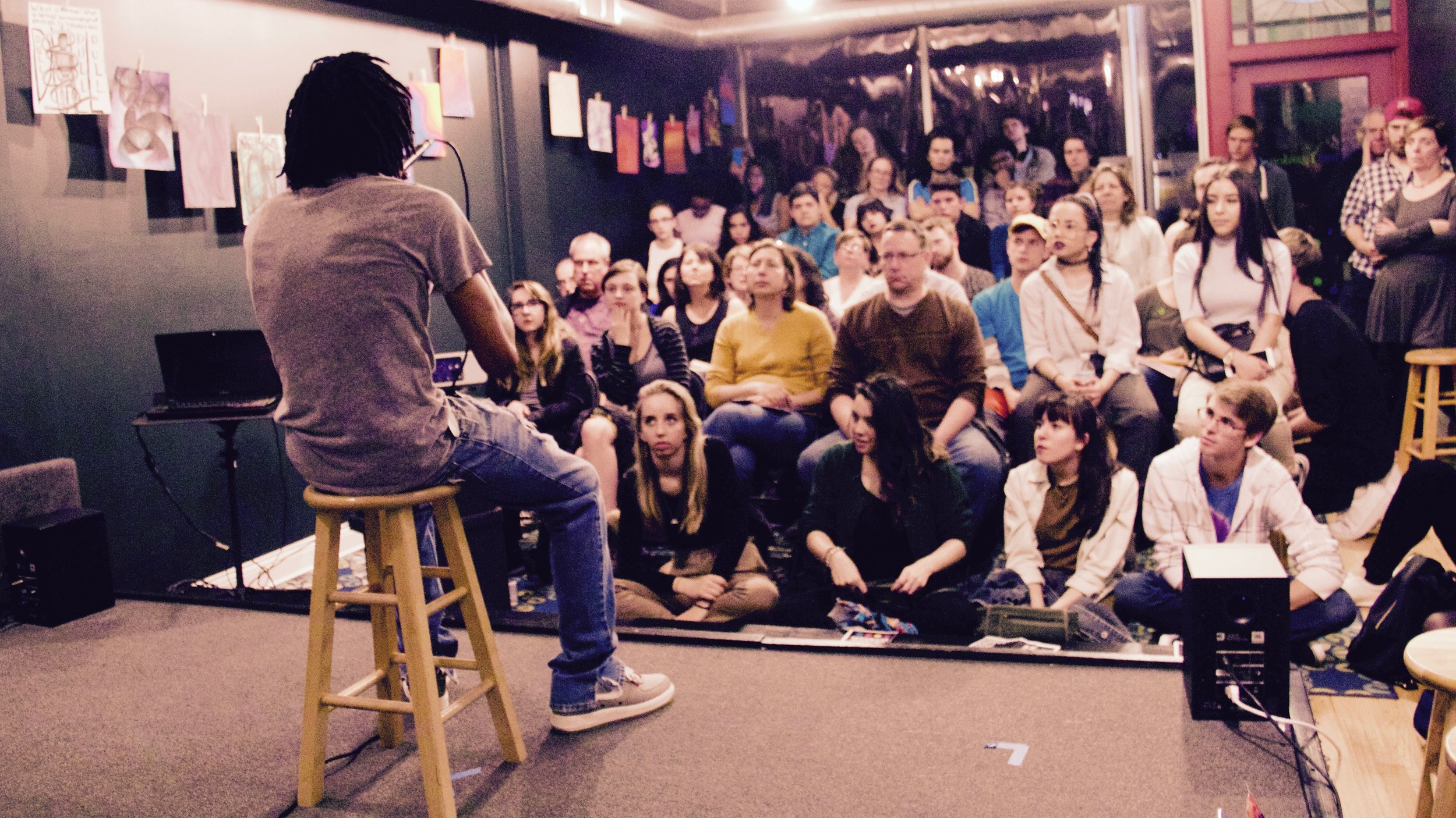 Spoken word artist performing in front of captive audience