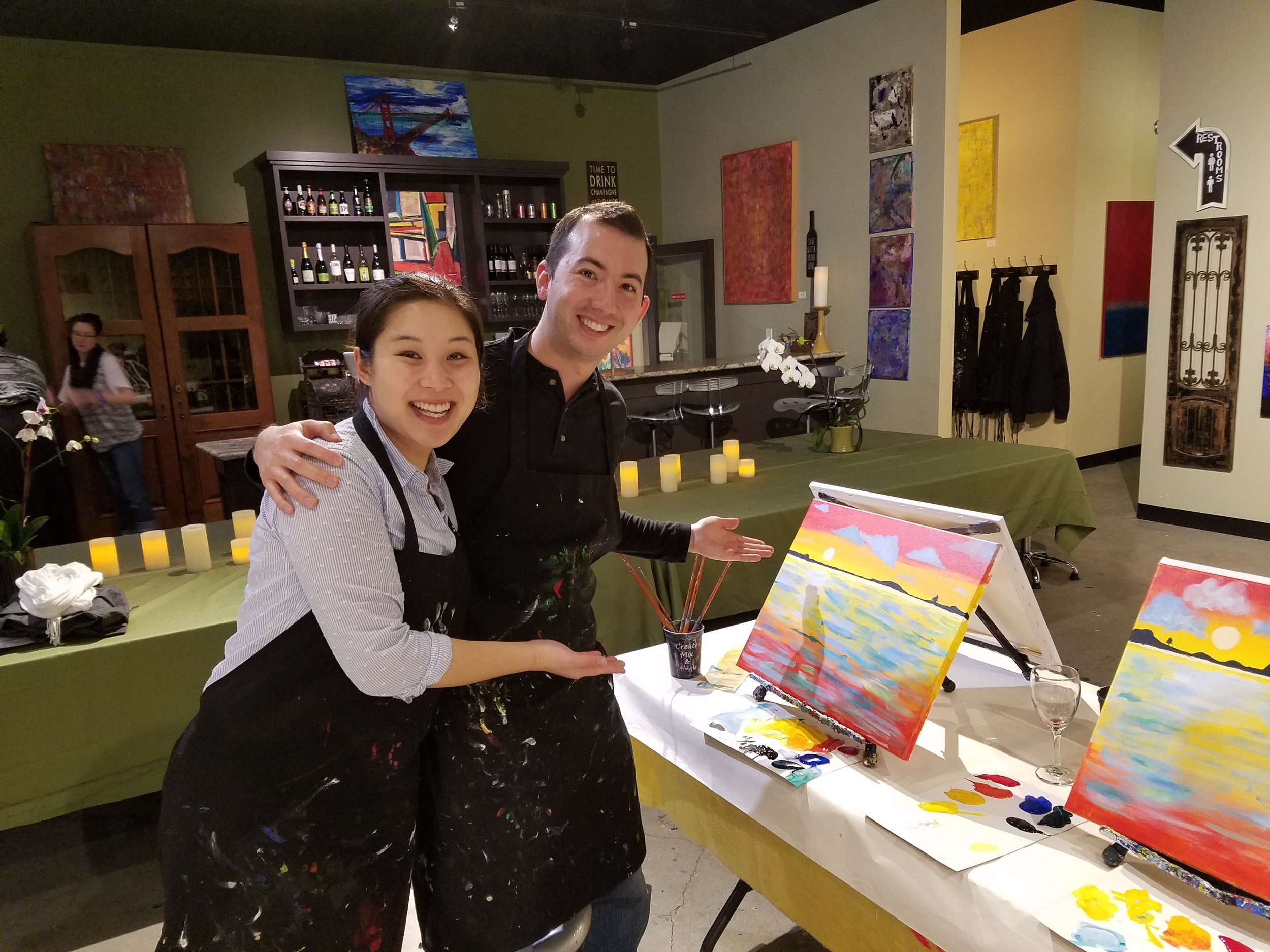 Wendy and Nick next to their paintings