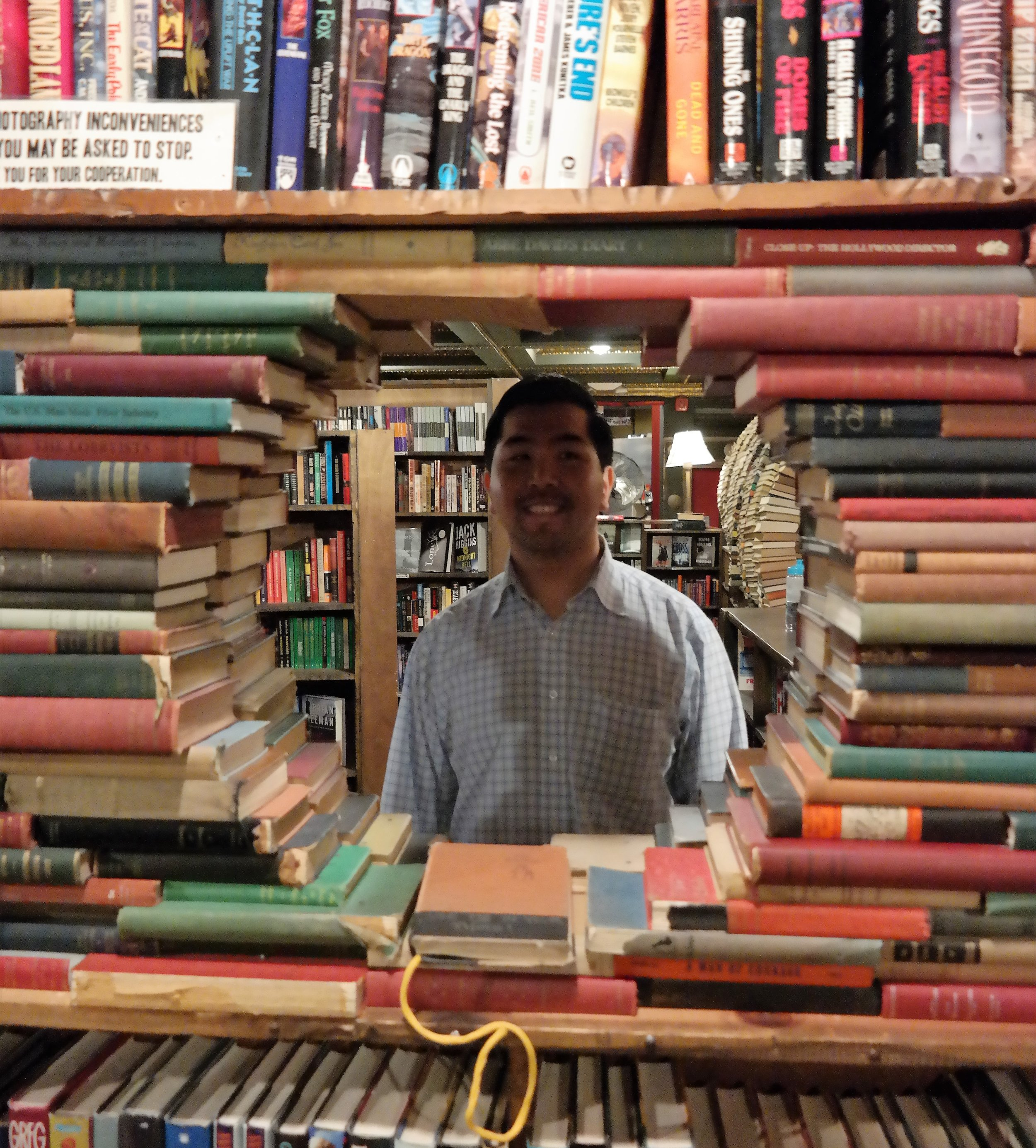 Justin through a wall of books