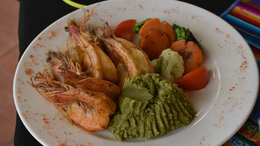A dish of shrimp with mashed otoy.