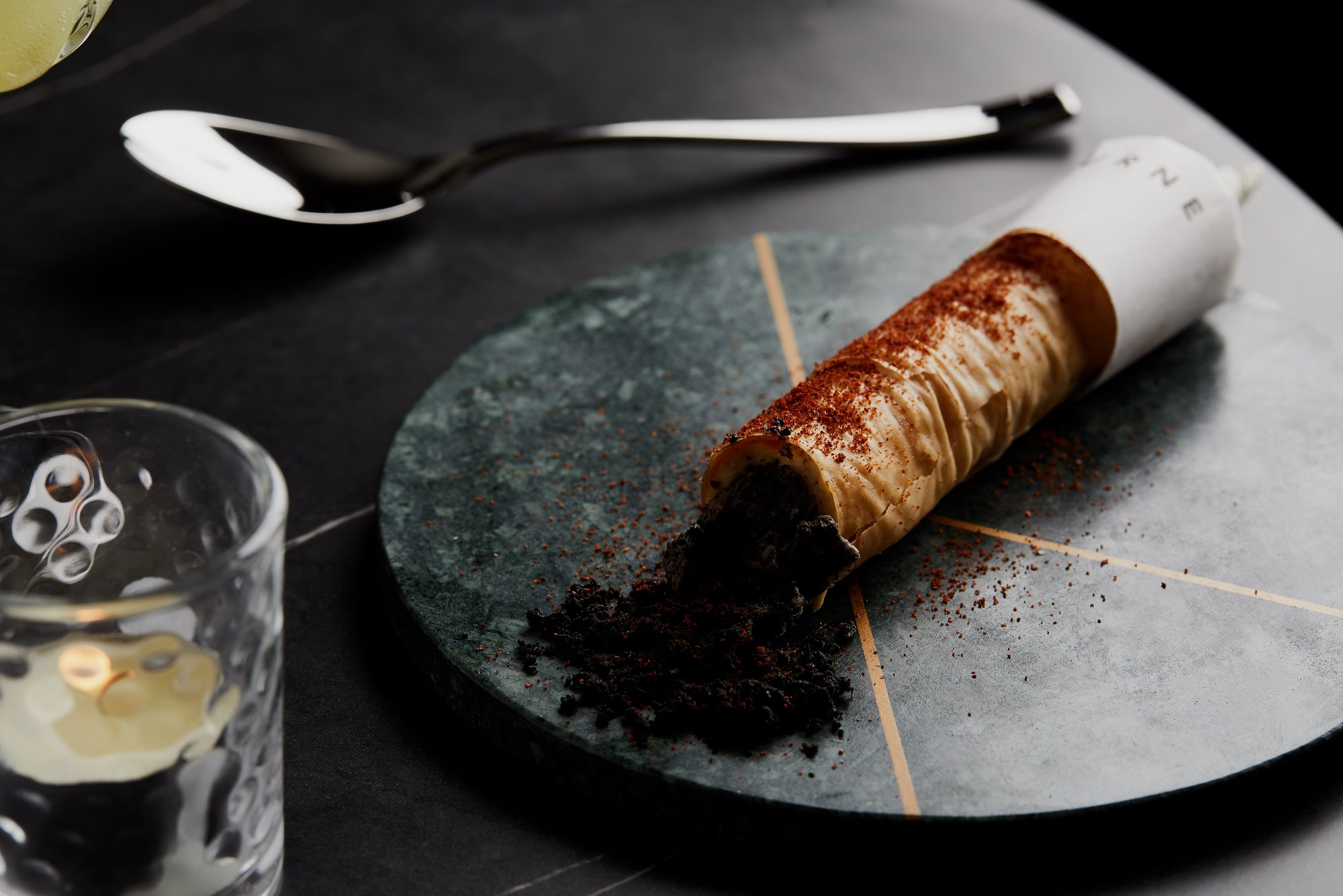 Dish-Smoked Hummus Cigar  stuffed with smoked paprika and served with a capsicum reduction.jpg