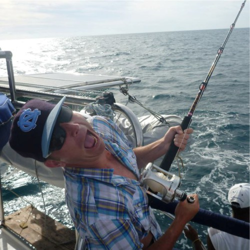 Having fun fishing from a charter holiday boat in Madagascar