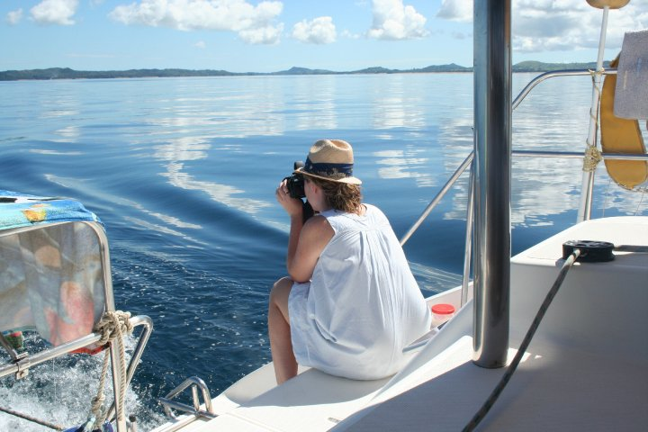 Lady taking photos from a charter boat in Madagascar