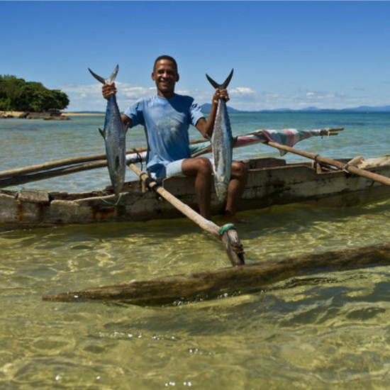 Local fisherman showing his catch at 293 on Komba