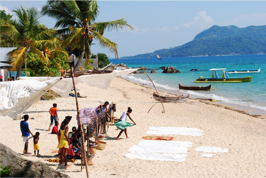 Locals and tourists enjoying the beach at 293 on Komba