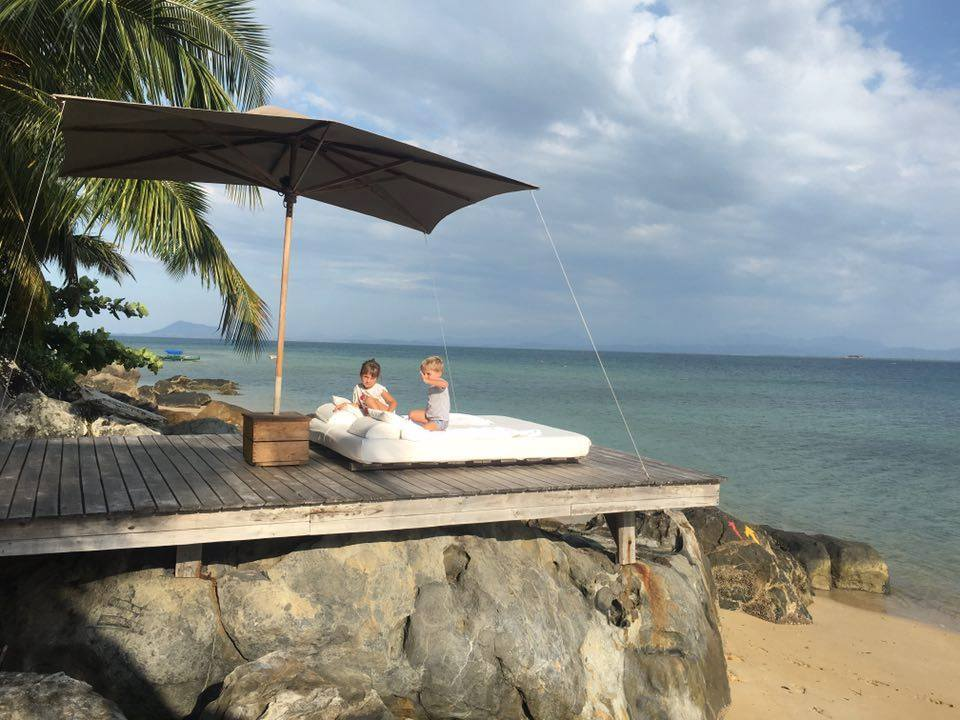 Couple relaxing on the deck on a rock at Tsara Komba Lodge