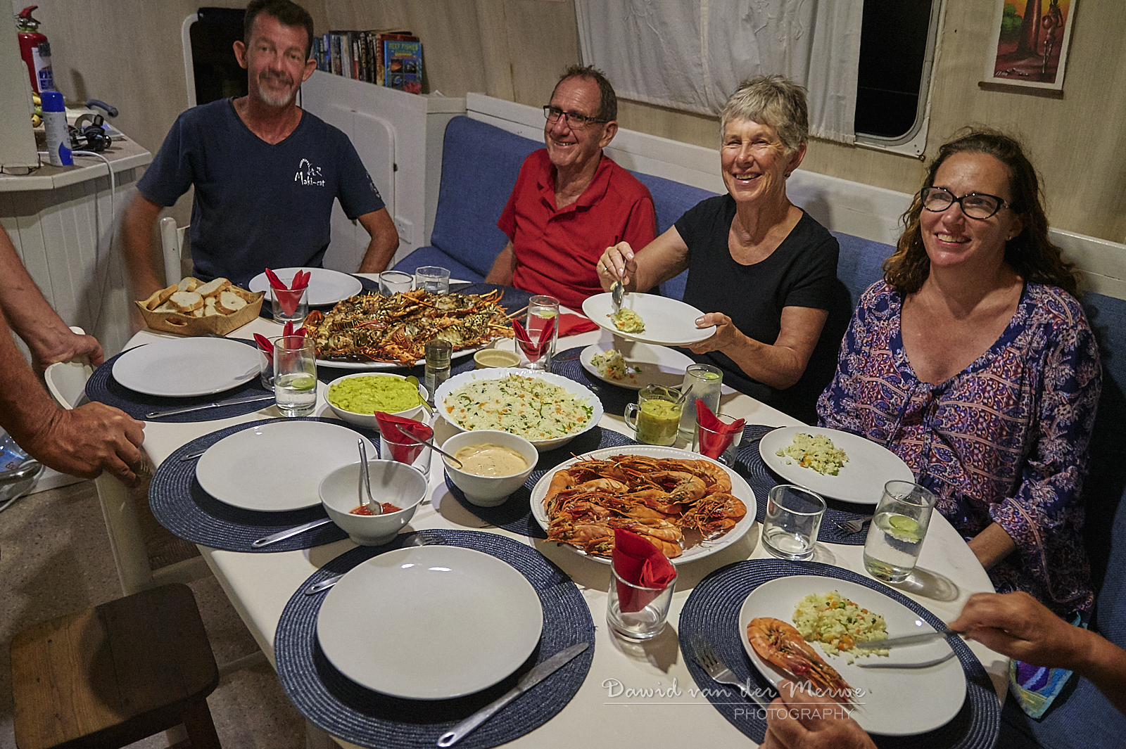 Seafood feast with family and friends on a charter yacht
