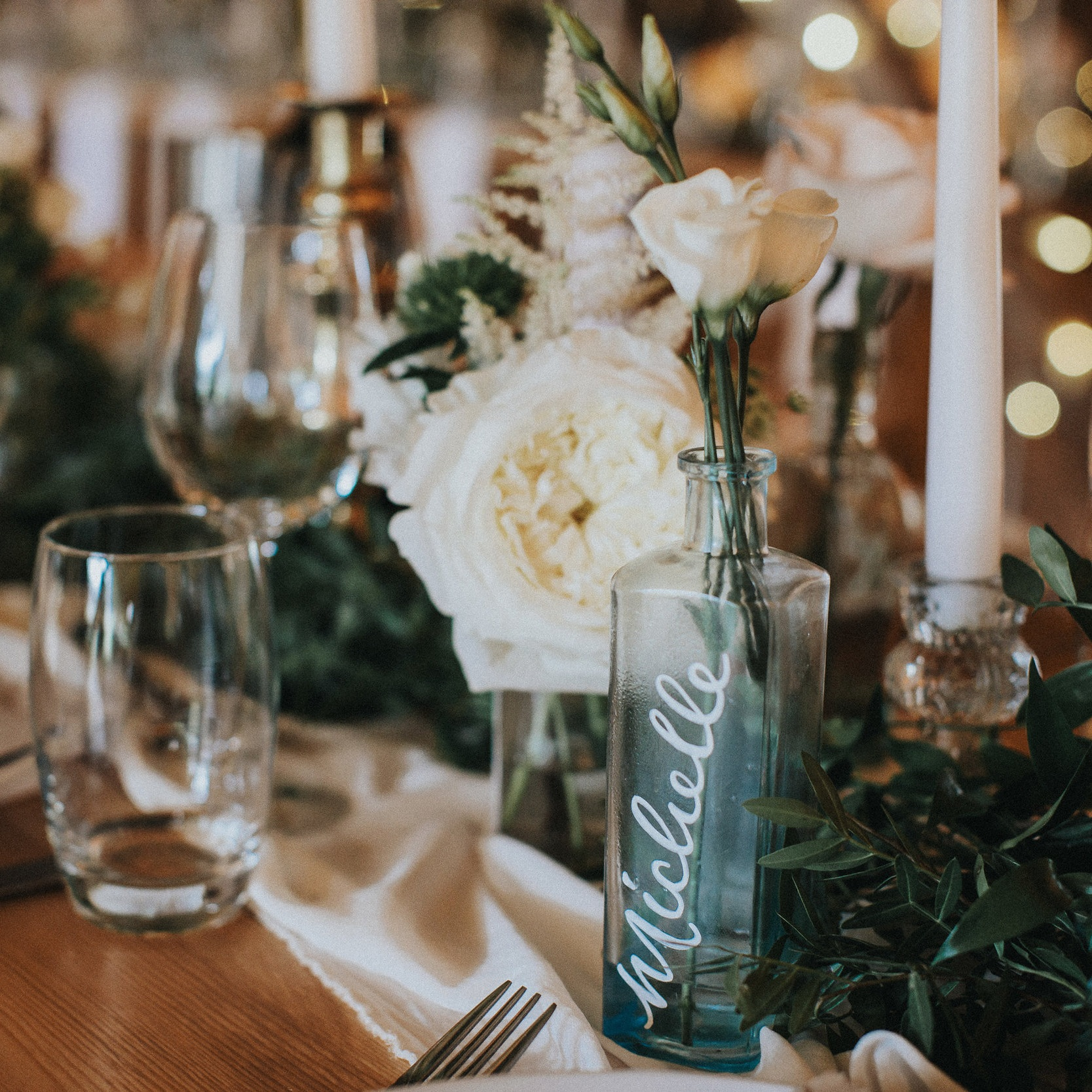 Personalised vintage glass bottles sourced by the couple made a beautiful keepsake for all the guests to keep. Captured by Matt Horan Photography.