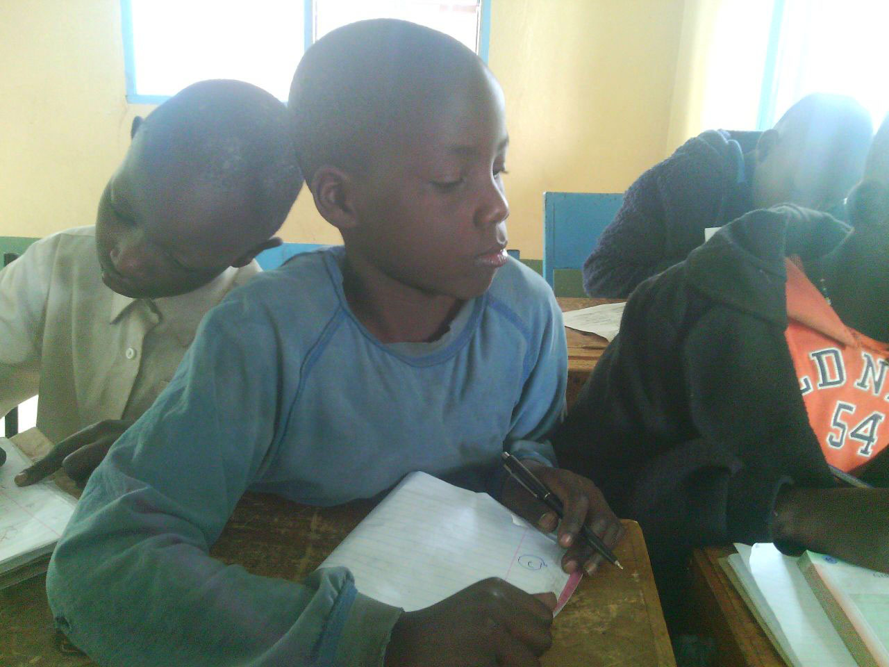 Fidel (center) loves studying math, and wants to be a doctor when he grows up.
