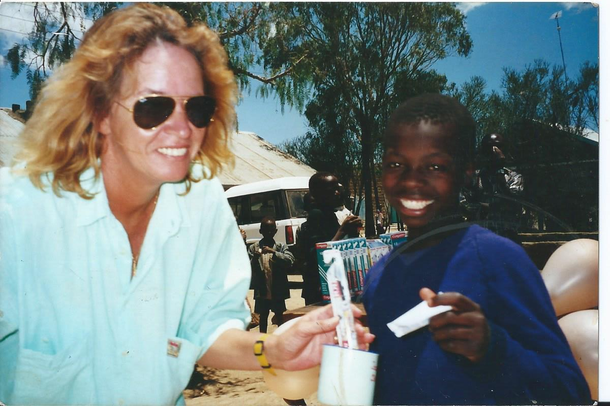 Debbie Case, the founder of Naivasha Children's Shelter with one of the boys during the feeding program at the YMCA. Debbie died peacefully in hospital on December 30, 2013 after being  diagnosed with cancer in June.    Having lost her own daughter in terrible circumstances she put an enormous amount of love and energy into the Shelter, which was opened in 2003.