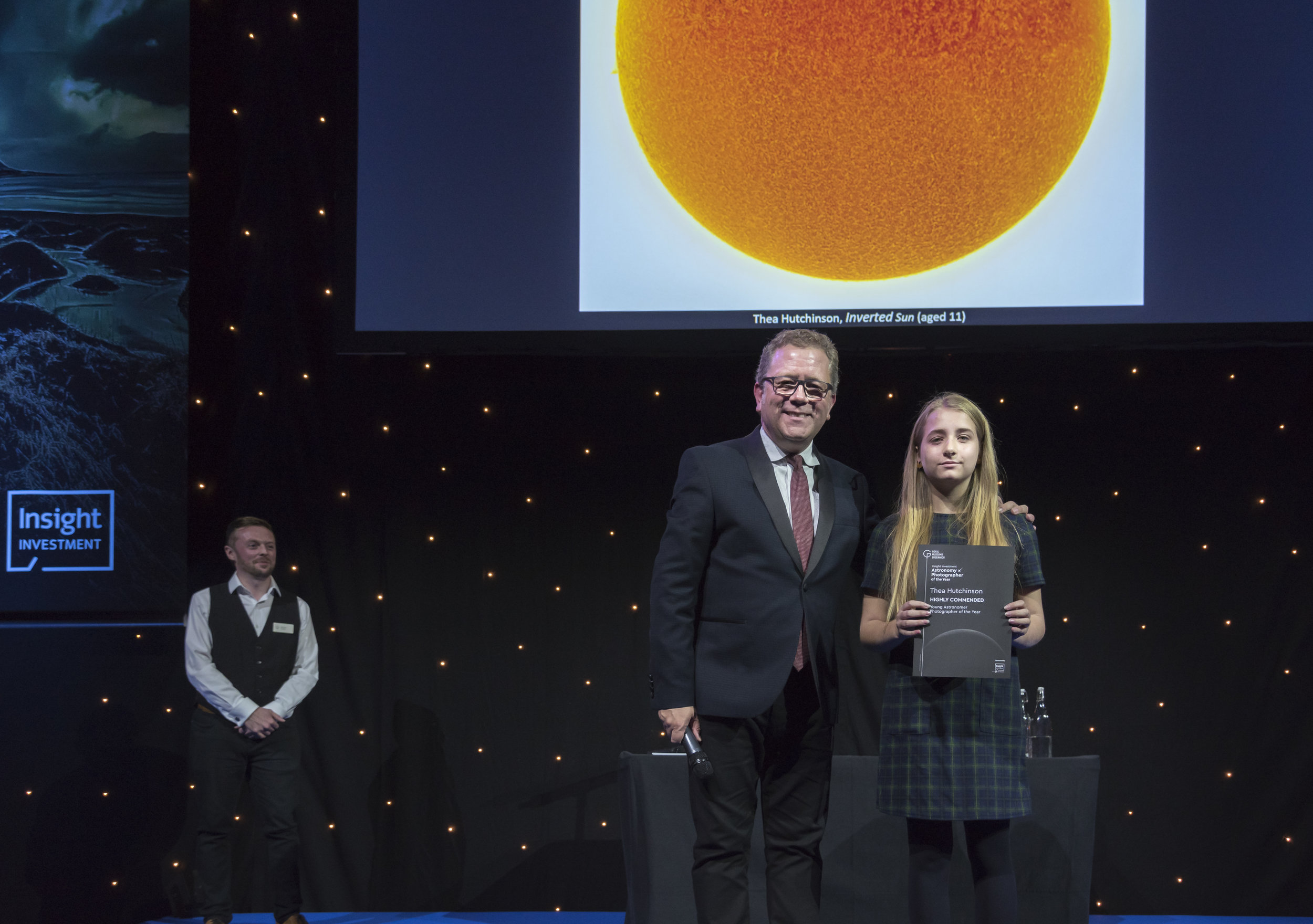 Thea receiving her Highly Commended certificate from Jon Culshaw   Copyright National Maritime Museum, Greenwich, London