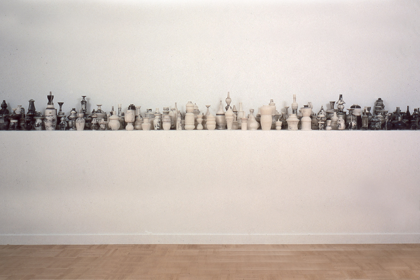 Building  ,  2003. Cast, reconstructed, glazed, fired porcelain. 23 foot installation.