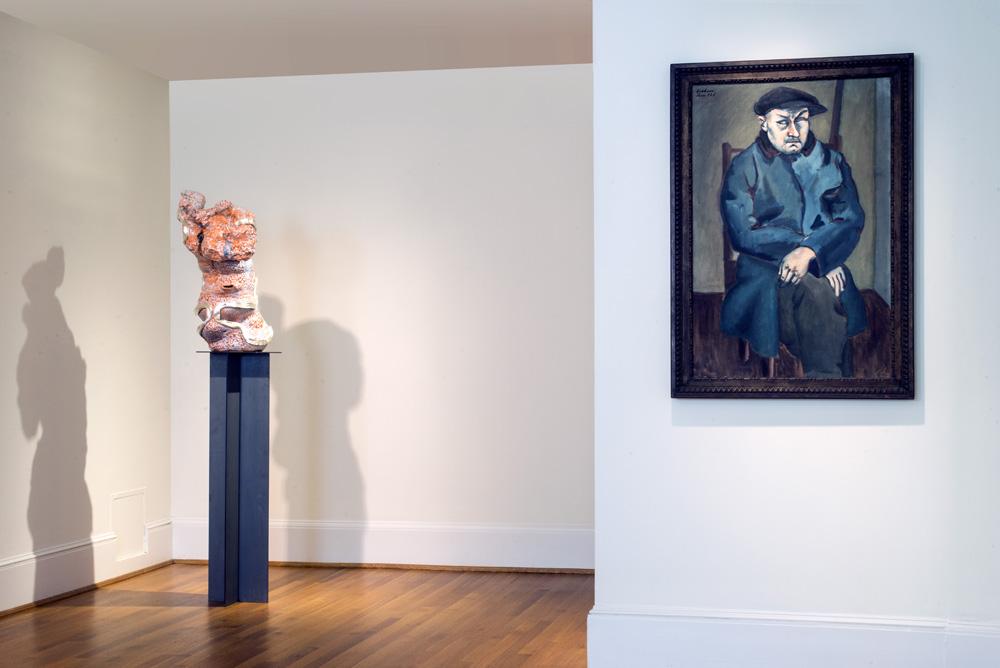 Arlene Shechet, Go Figure , 2016. Glazed ceramic, gold, steel. 72.62 x 16 x 13.5 inches. John D. Graham,  Blind Man  ,  1928. Oil on canvas. 39.5 x 25.75 inches.