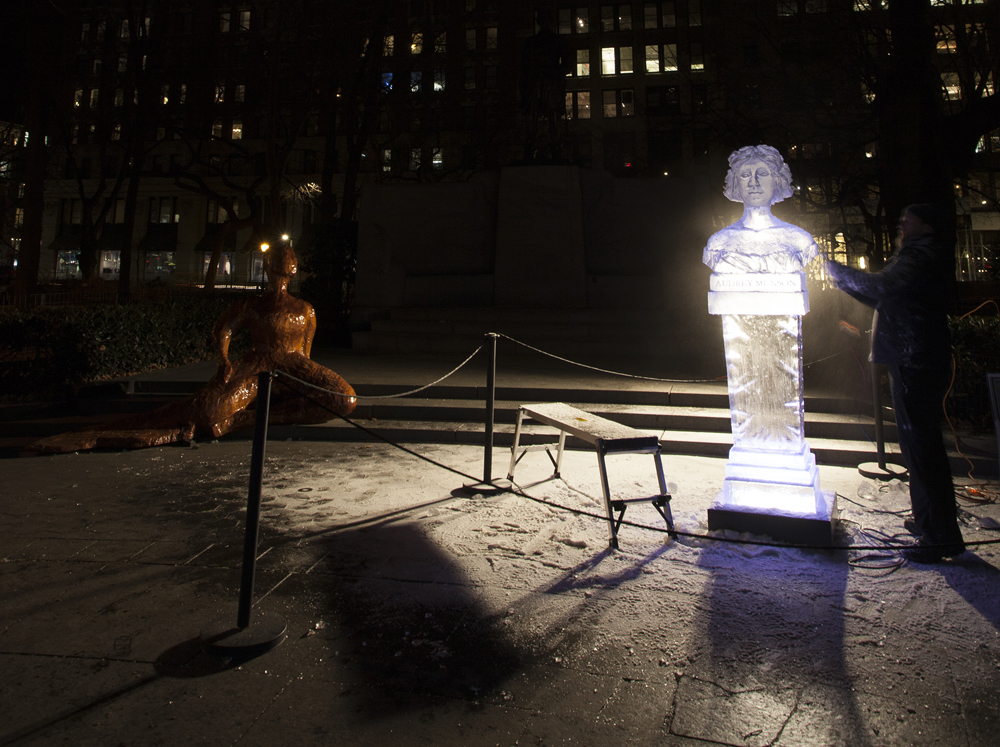 Ice carving  after the figure Audrey Munson (right), beside  Forward  (left); performed by Okamato Studios in  Full Steam Ahead , February 1, 2019. Photograph by Rich Lee.