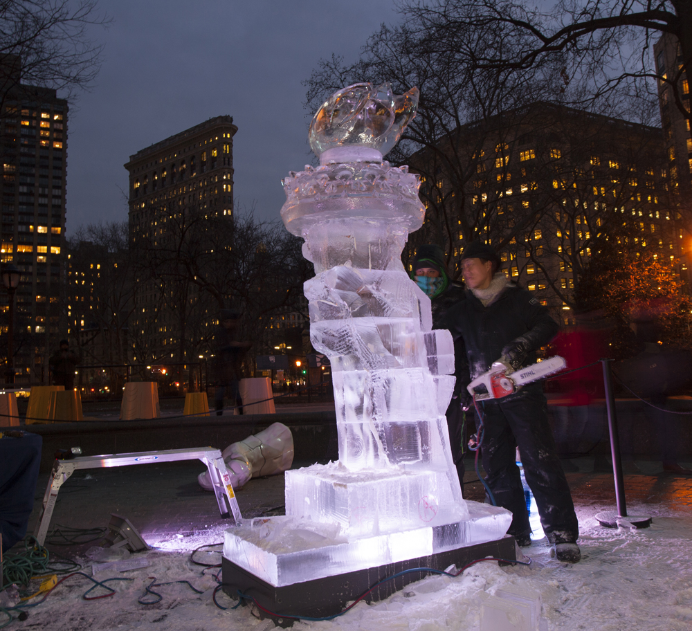 Ice carving  after the Statue of Liberty's torch; performed by Okamato Studios in  Full Steam Ahead , February 1, 2019. Photograph by Rich Lee.