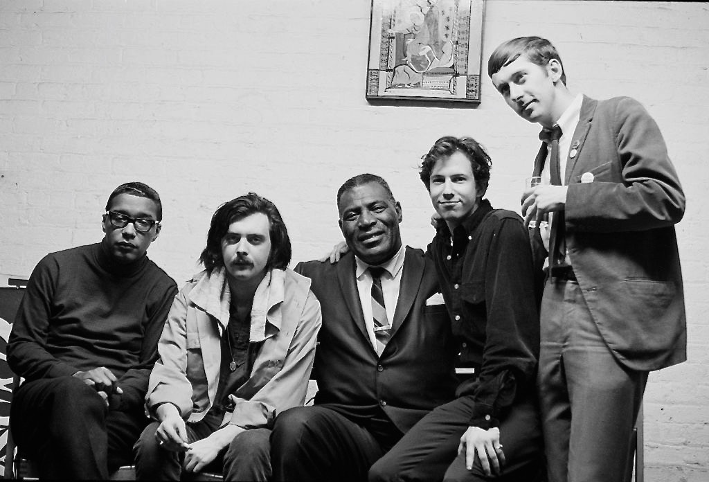January 1967 - New York City -Cafe Au Go Go - Early Siegel-Schwall Band on tour with Howlin' Wolf;    Left to Right: Jack Myers (bass), Jim Schwall, Howlin' Wolf, Me on Wolf's knee, Russ Chadwick (drums)    Wolf used to knock on Corky's door every morning and they'd take walks in the Village.  Wolf loved the idea of brining blues to classical audiences.
