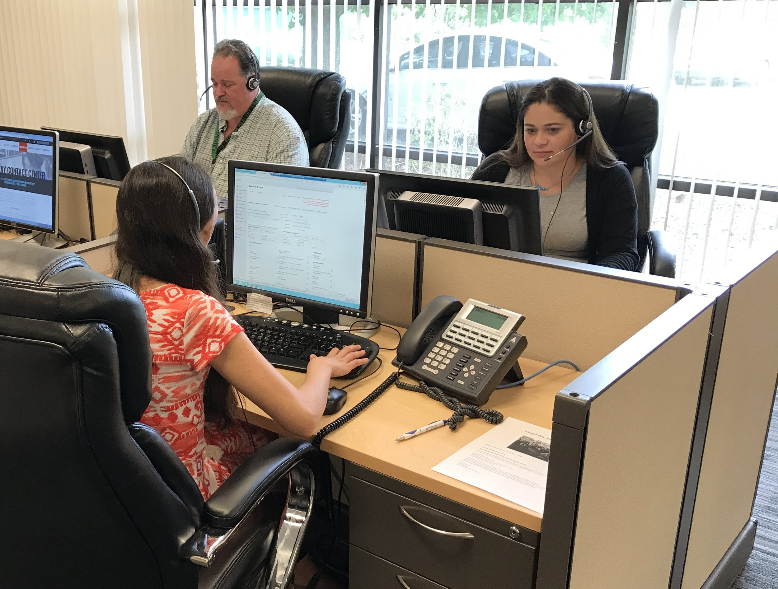 Specialists answering calls at the Crisis Center of Tampa Bay