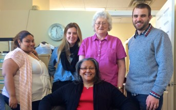 Helene Rodriguez, left, and other Housing staff