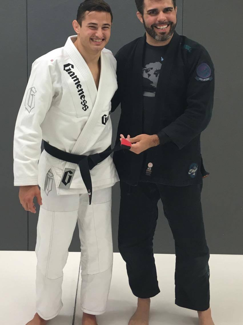 Professor Josh Ketry poses with World Champion Caio Terra while wearing the  BUZZ Sight  long sleeve.