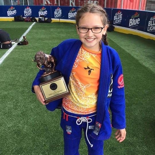 Maddie and her Super Fight trophy. (BUZZ Heat)