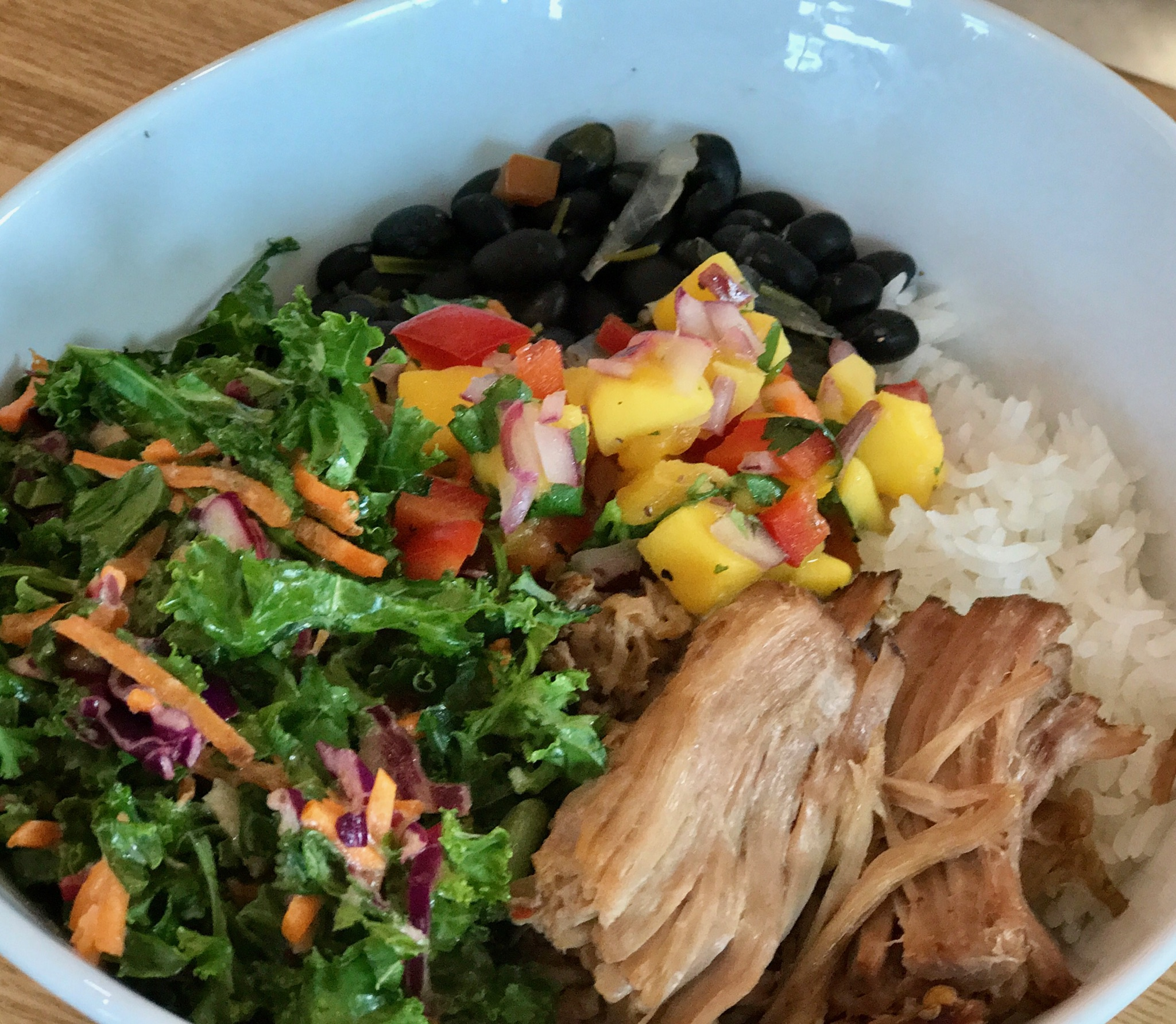 Slow roasted pork, black beans, mango salsa, kale salad, and jasmine rice never disappoints.