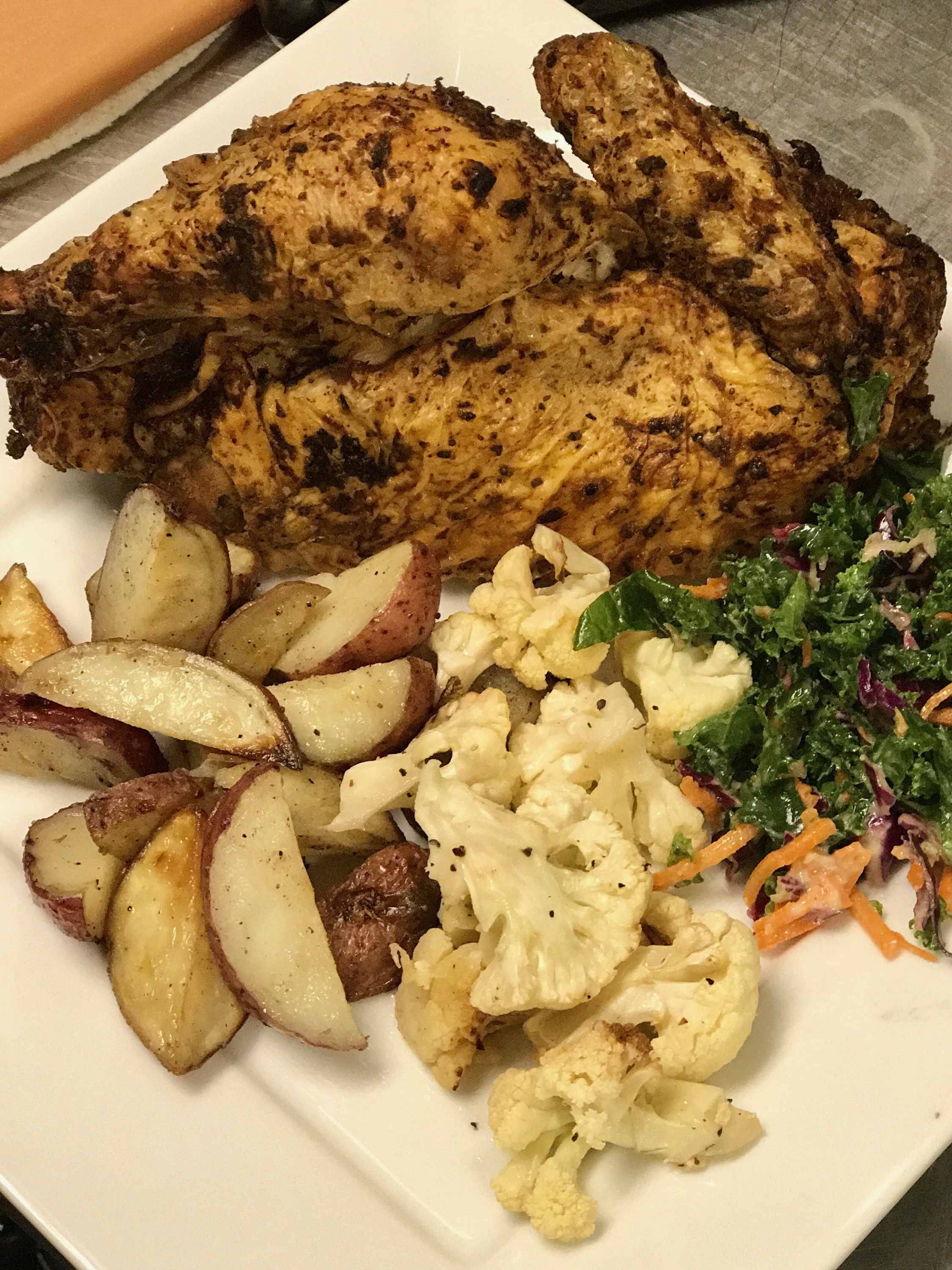 THIS IS OH SO GOOD, WE LOVE IT WITH A BIG GLASS OF PINOT NOIR. Half roasted chicken, roasted fingerling potatoes, seasonal vegetables, jerk sauce, romesco sauce