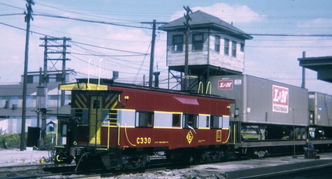 Between 1972 and 1973, No. C330 was repainted again into to the Erie Lackawanna's maroon and grey scheme. The No. C330 is seen here passing the Marion, OH tower in 1973.  (Gene Dent photo)