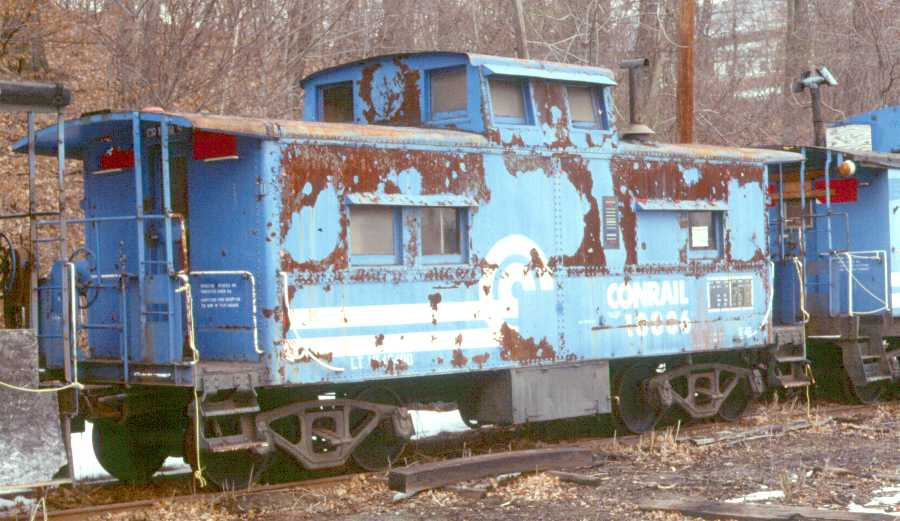 No. 18886 sits in Whippany, NJ in March of 1988, less than two years   after Tri-State acquired it from Conrail. The circle bleeding through the Conrail paint on the cupola indicates the CNJ paint job this caboose received, erasing its L&NE heritage.   (Karl Geffchen photo)