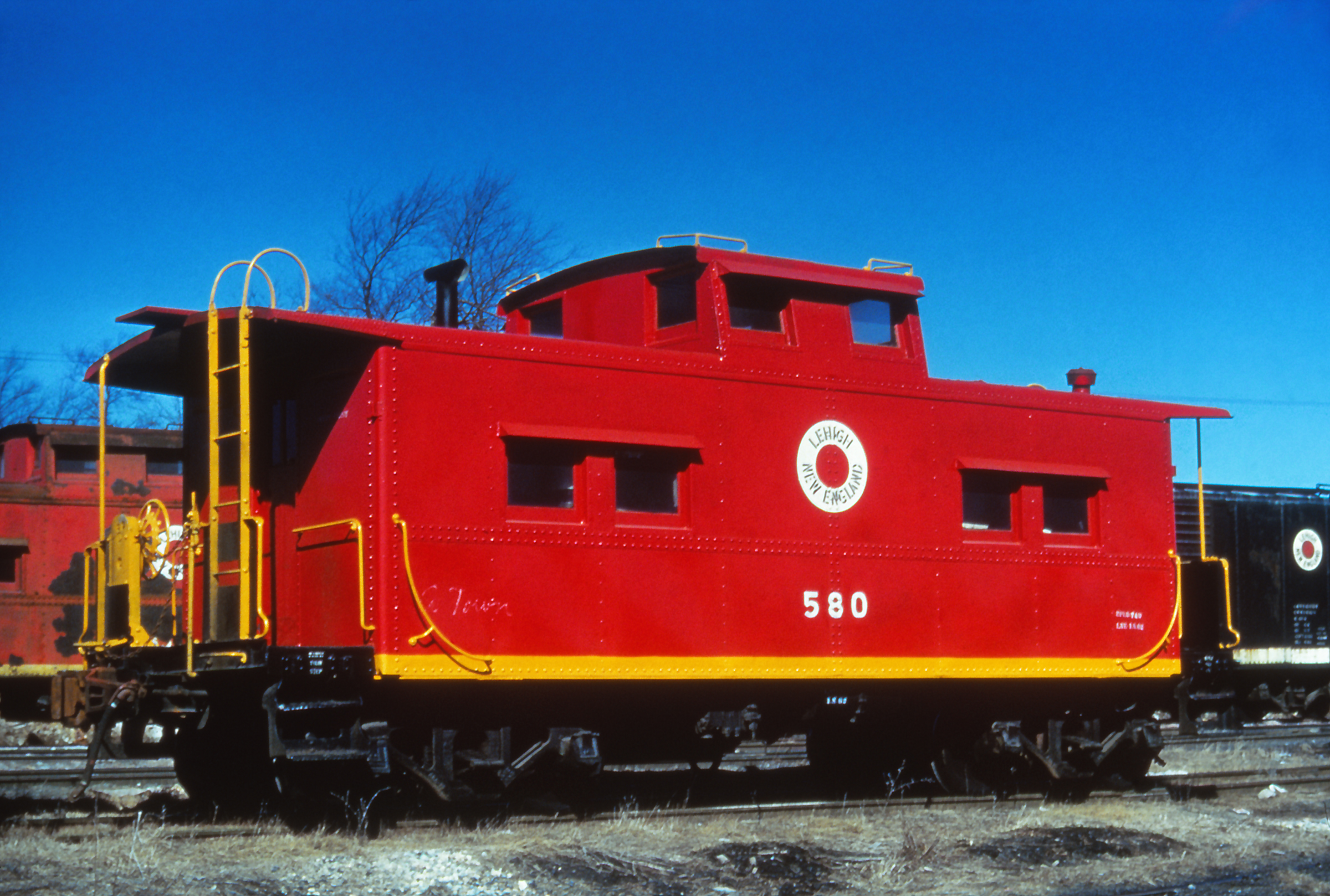 Sitting in the yard in Tadmor, PA, L&NE No. 580 sports a new coat of paint in March of 1961. In just a few short months, the L&NE would cease to exist as an independent railroad, and No. 580 would join the CNJ roster.  (Rudy Garbely collection)