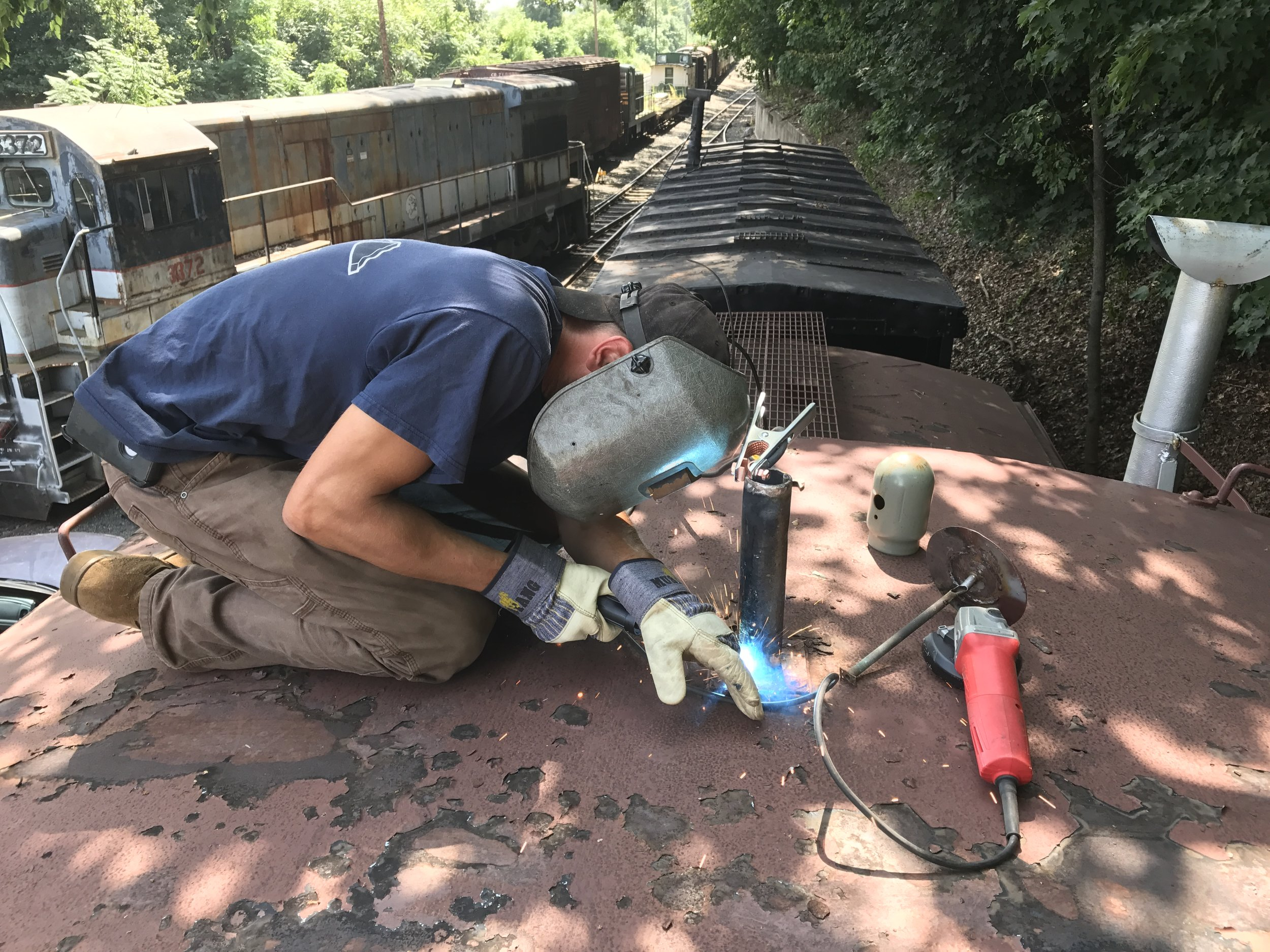 Volunteer Erik Stenzel re-fabricates the rusted radio antenna on the cupola.