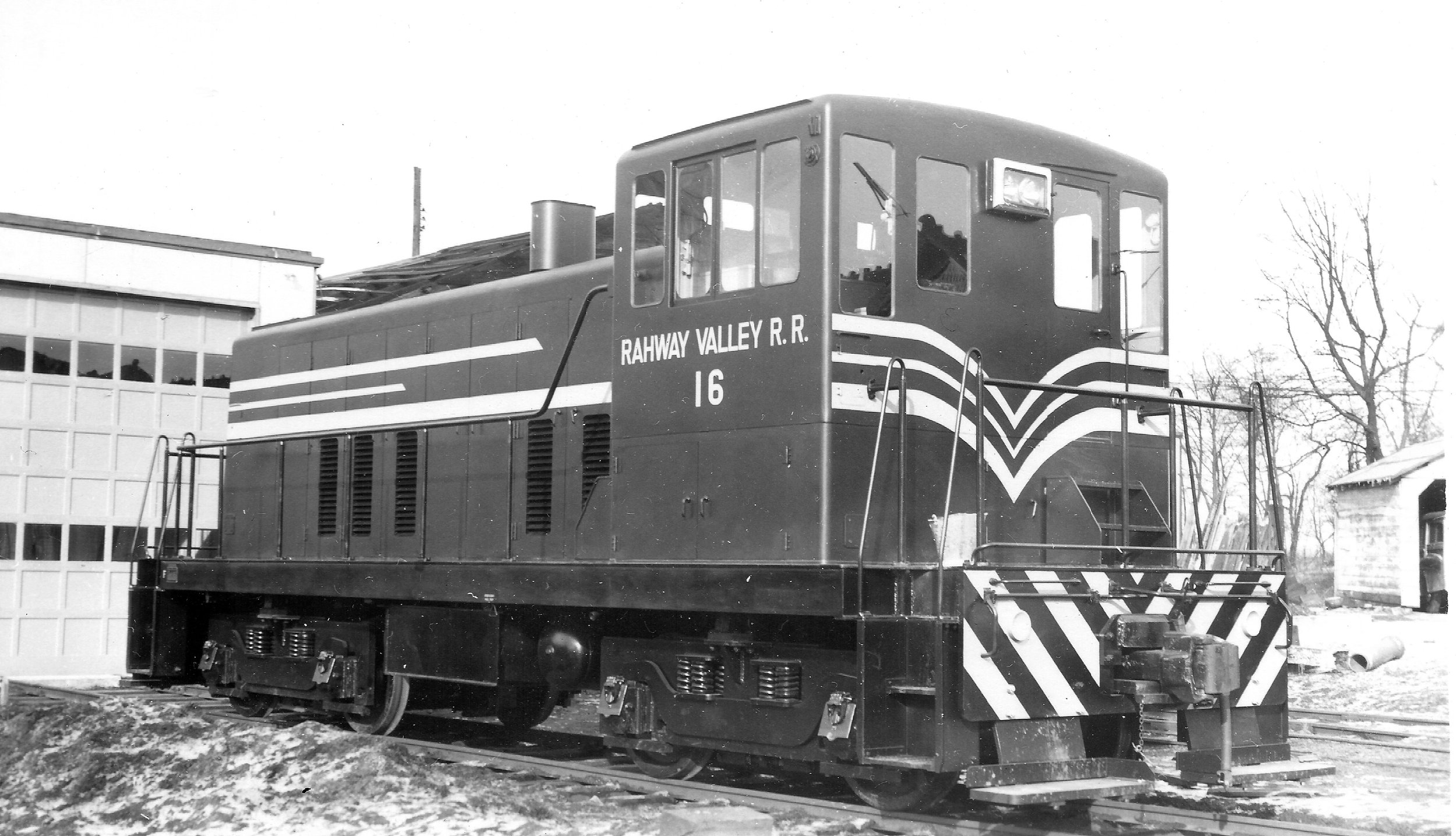 No. 16 is pictured in Kenilworth, NJ, the site of the RV's headquarters, on January 30, 1951. The one-stall engine house seen in front of the locomotive was constructed specifically to house the RV's first diesel.  (William S. Young photo, Richard J. King collection)