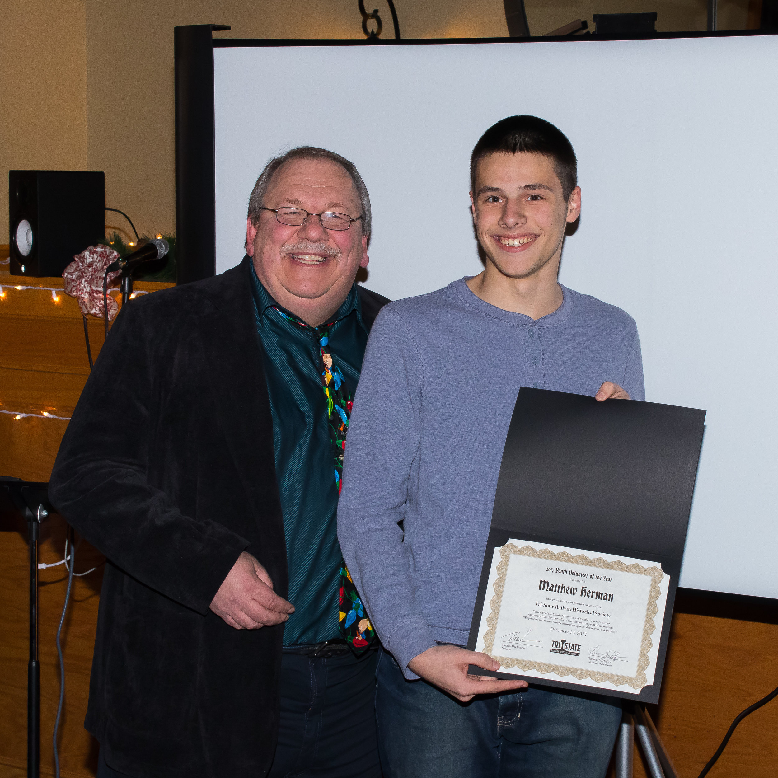 """President Michael Del Vecchio with presenting member Matthew Herman with the """"Youth Volunteer of the Year"""" Award"""