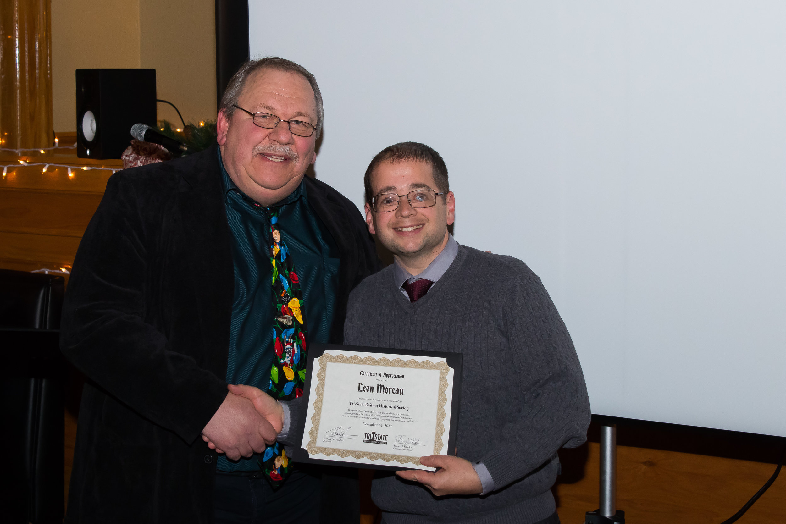 Member Leon Moreau receives a donor Certificate of Appreciation