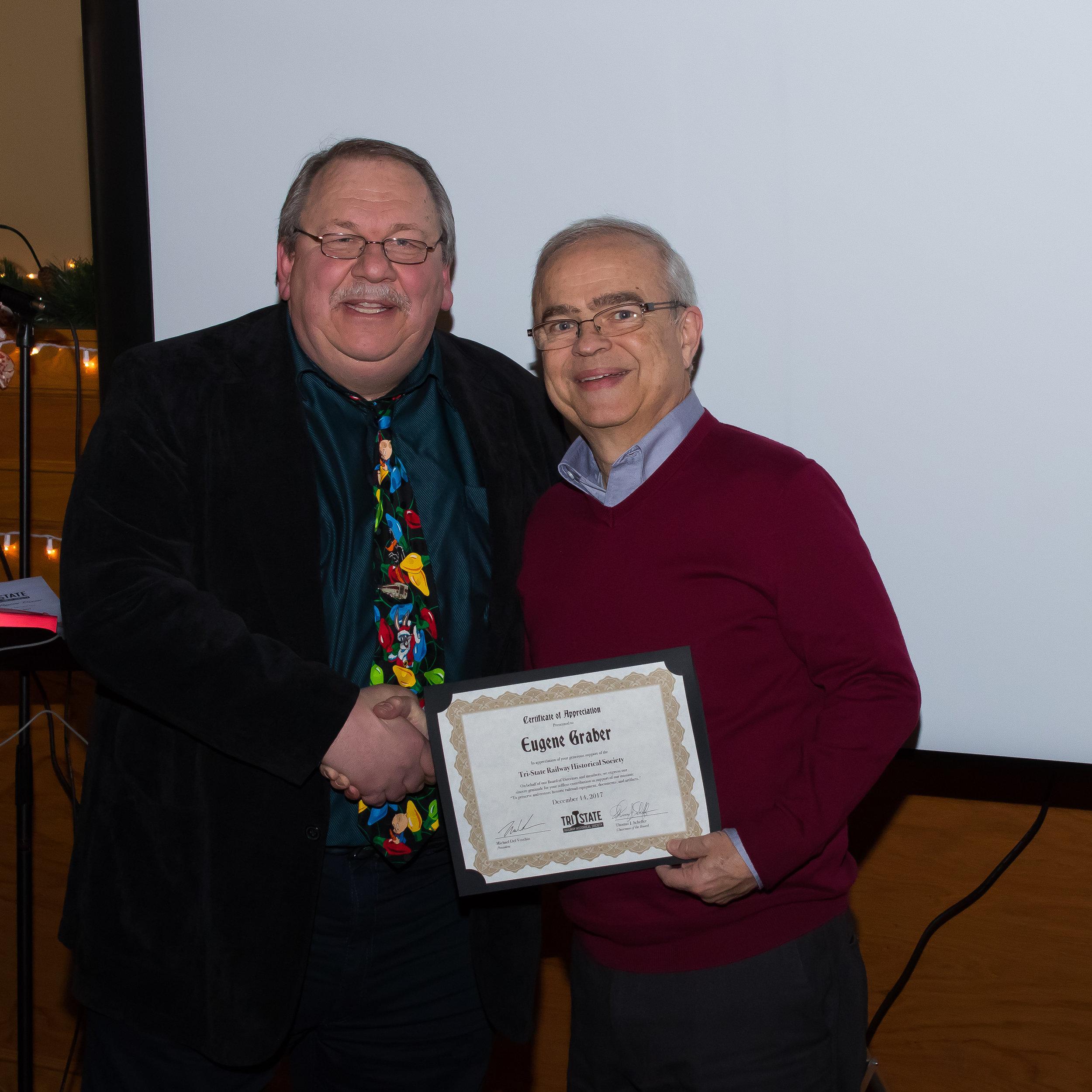 Member Eugene Graber receives a donor Certificate of Appreciation