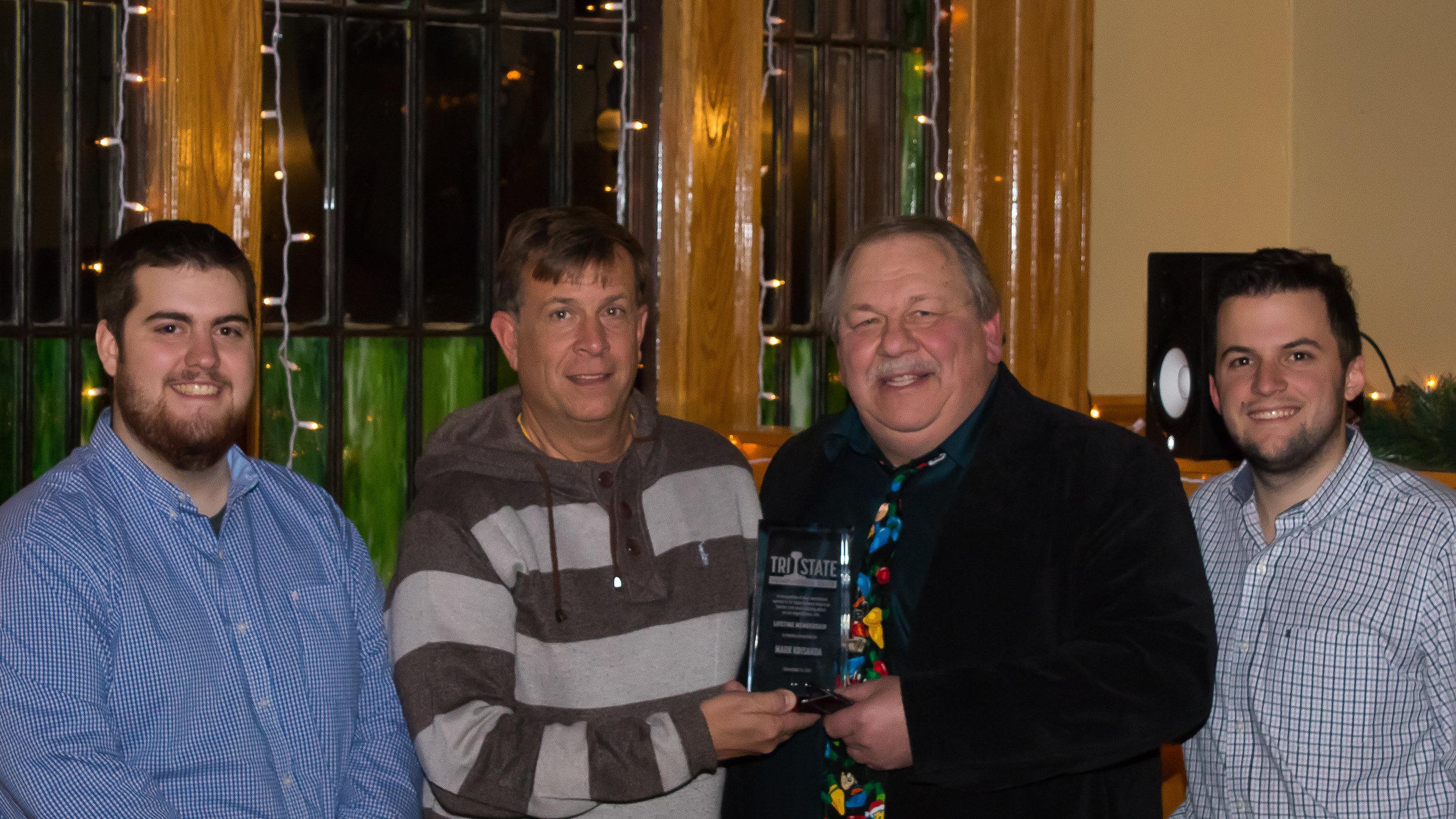 Member Mark Krisanda receives his Lifetime Membership award. From Left to right, Vice President Kevin Phalon, Mark Krisanda, President Michael Del Vecchio, and Treasurer Richard King.